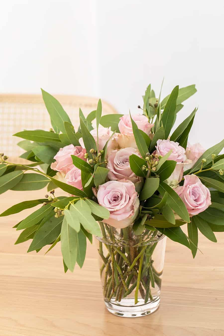 side shot of pink roses in a vase