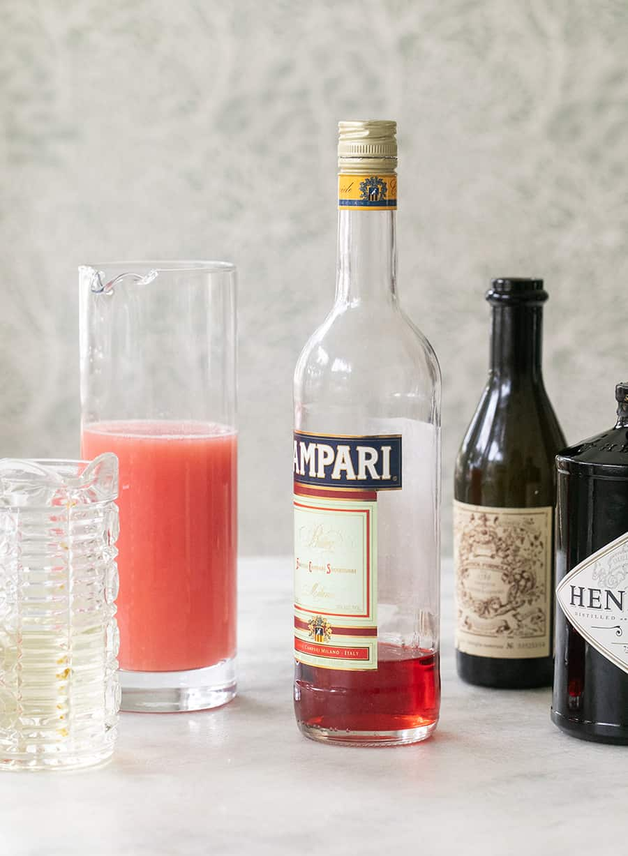 Ingredients for making grapefruit Negroni popsicles