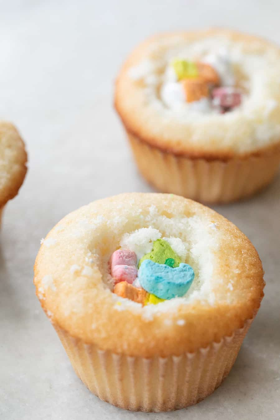 Lucky Charms Cupcakes filled with marshmallow fluff.