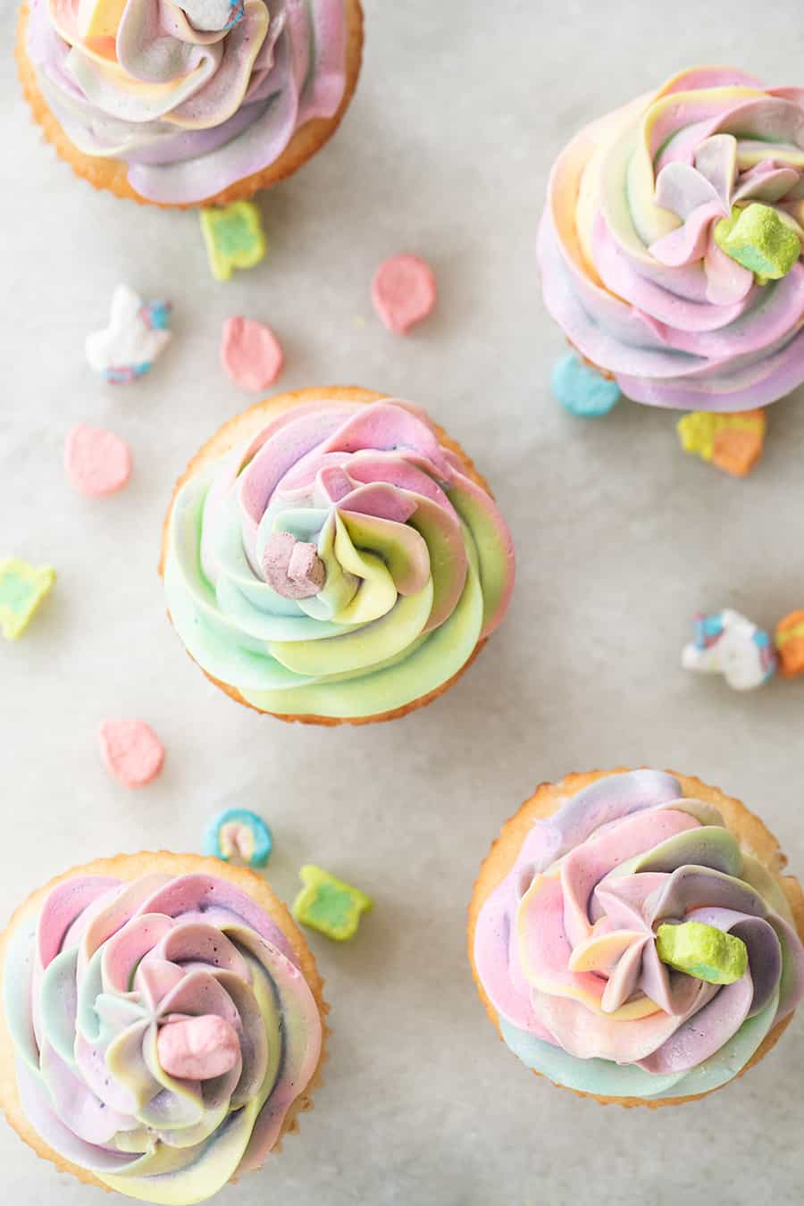Rainbow buttercream frosting on Lucky Charms Cupcakes for Saint Patrick's Day.
