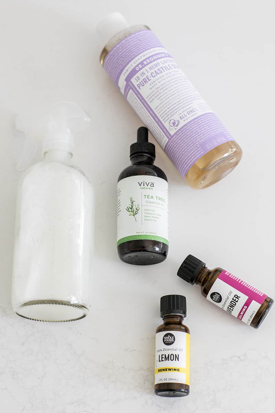 Lavender Essential Oil, Lemon Essential Oil, Tea Tree Oil, Castile Soap and a Clear Spray Bottle for Making DIY Cleaning Products