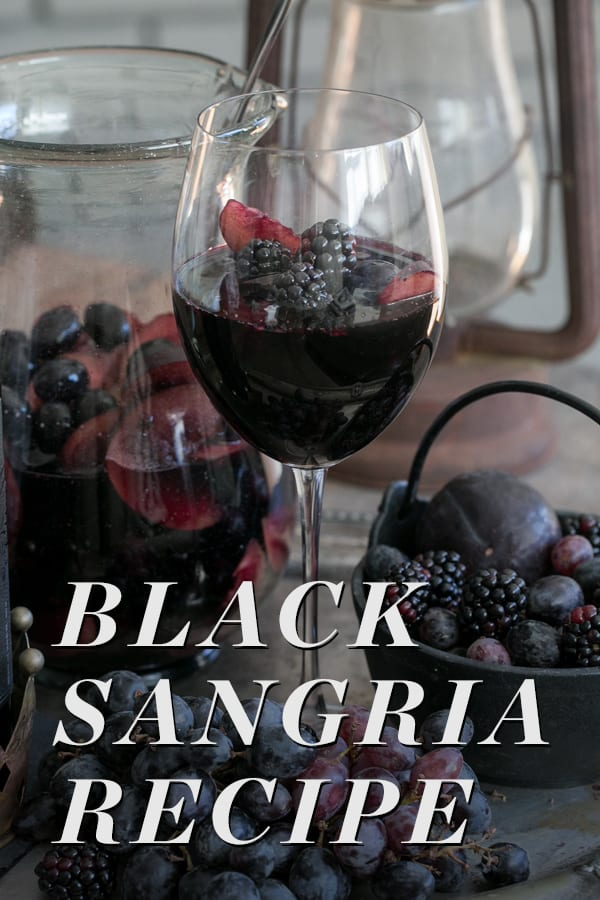 A glass of black sangria with text overlay
