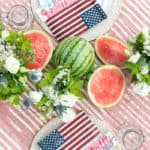 4th of July party ideas and table setting with watermelon centerpiece and burlap flags