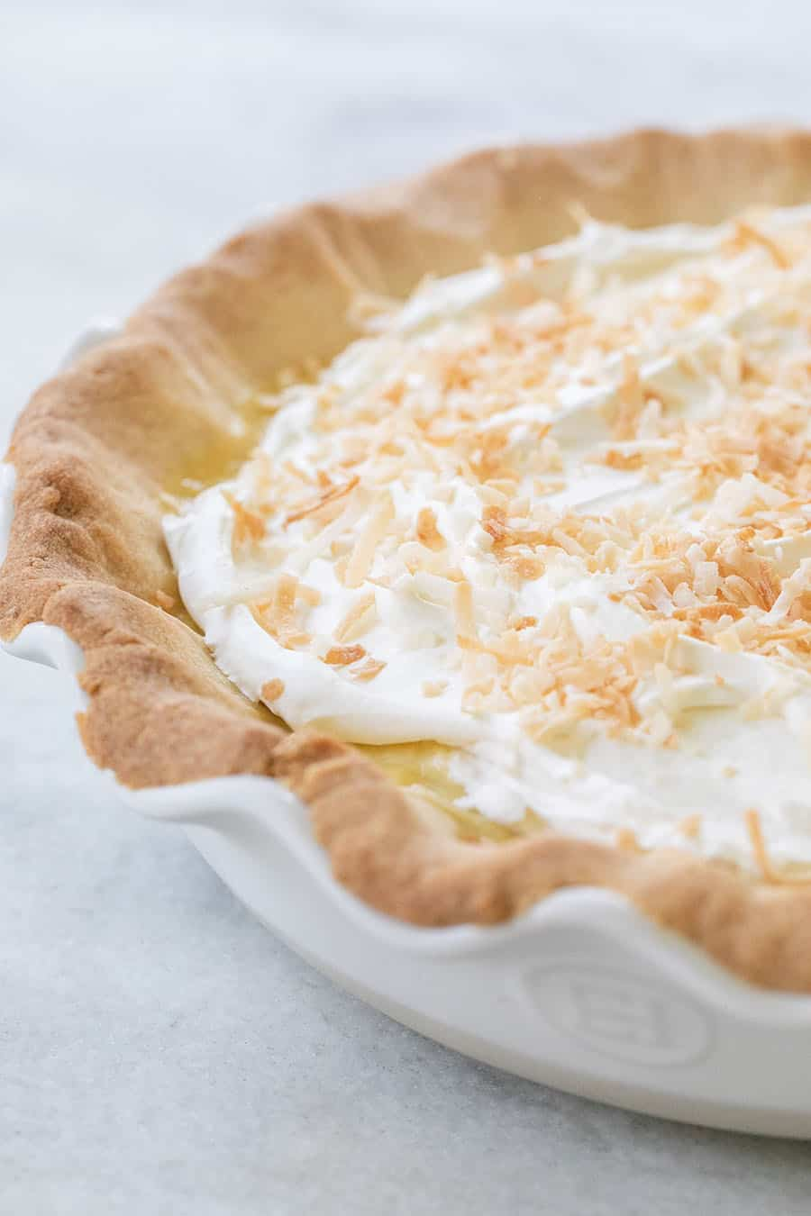 Coconut cream pie with whipped cream and toasted coconut.
