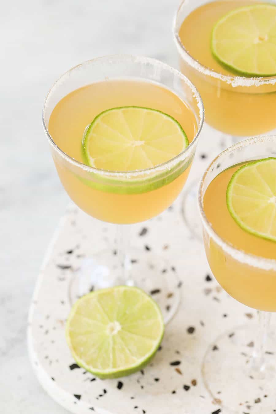 Three Ingredient Classic Daiquiris on a marble table.