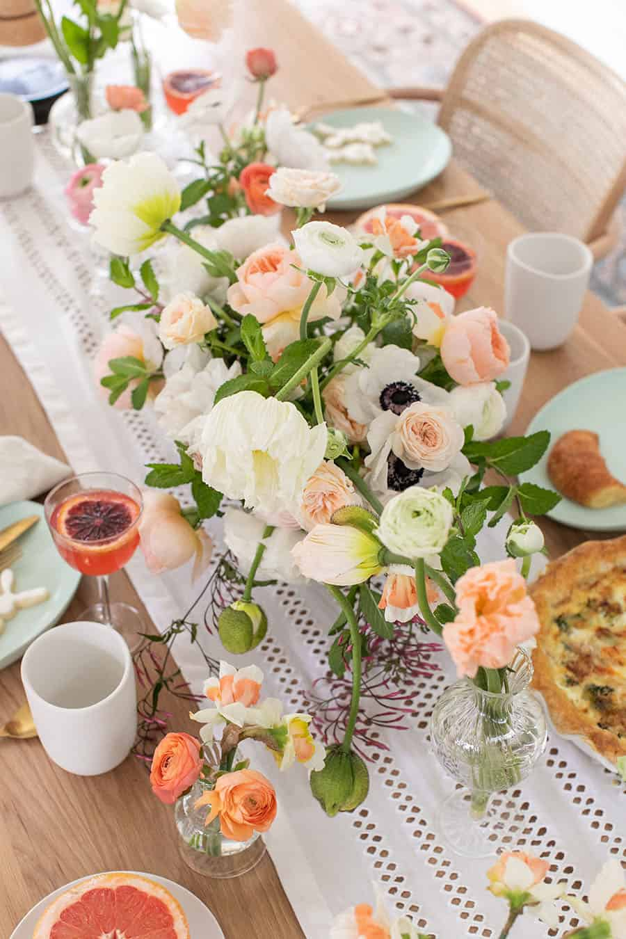 Stunning flowers on a table setting for Easter brunch.