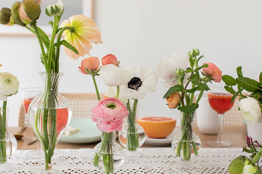 Flowers in mini vases.