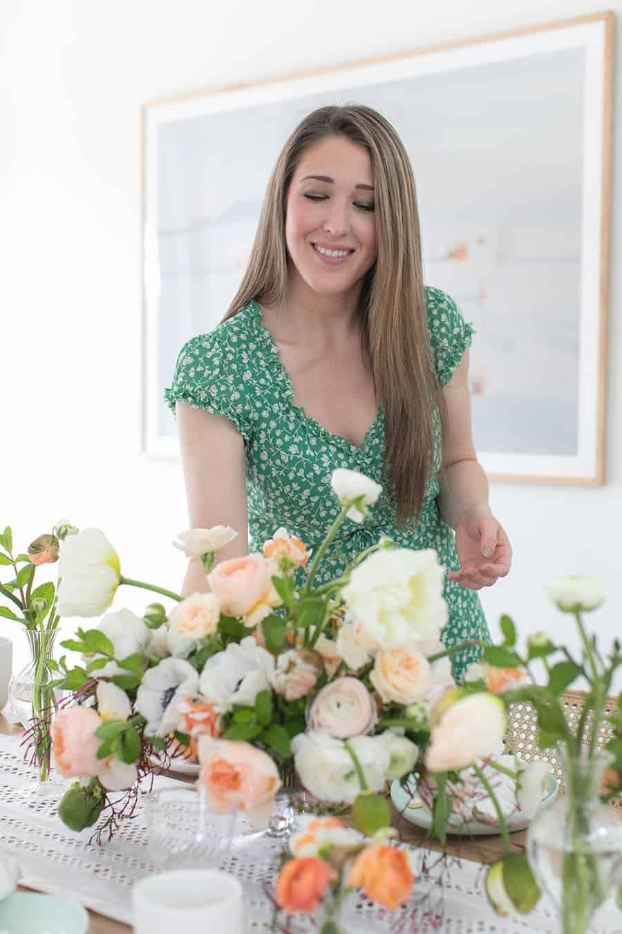 Eden Passante setting flowers down on an Easter table setting
