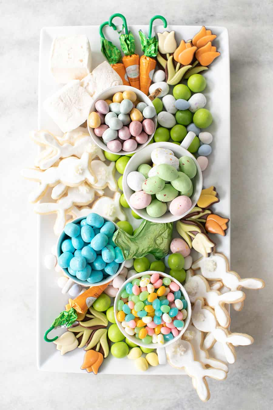 Tray of Easter candy on a marble table.