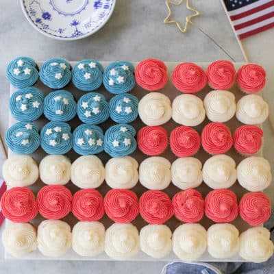 overhead photo of American flag made out of cupcakes