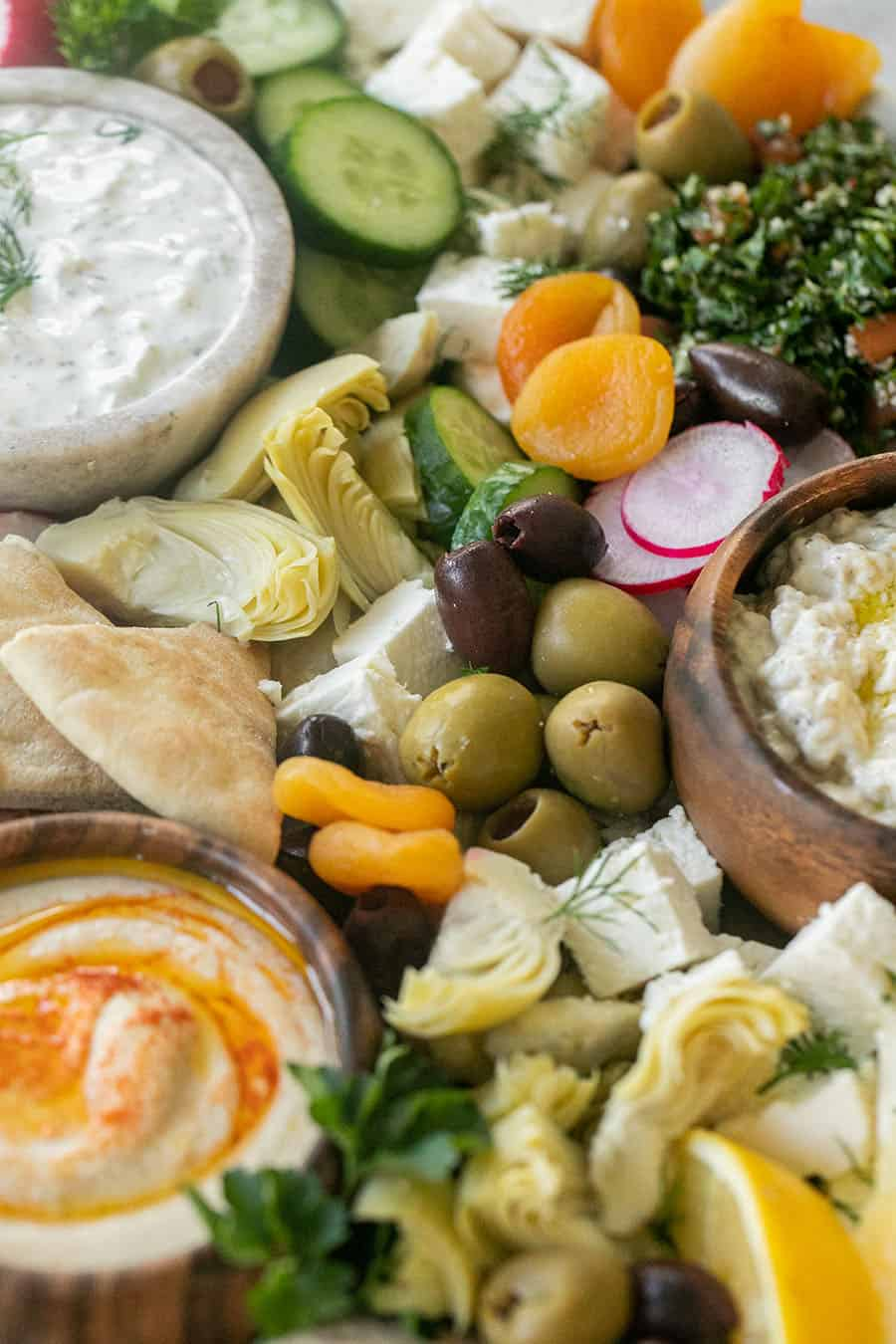 Easy Greek Mezze Platter with green olives, feta cheese and reddish.
