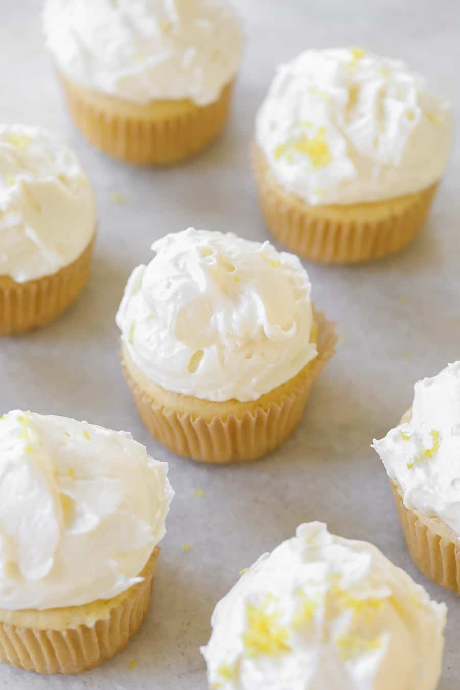 Lemon Cupcakes with Buttercream Meringue Frosting on a marble table