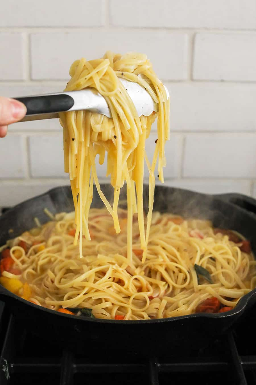 Holding noodles above a cast iron skillet