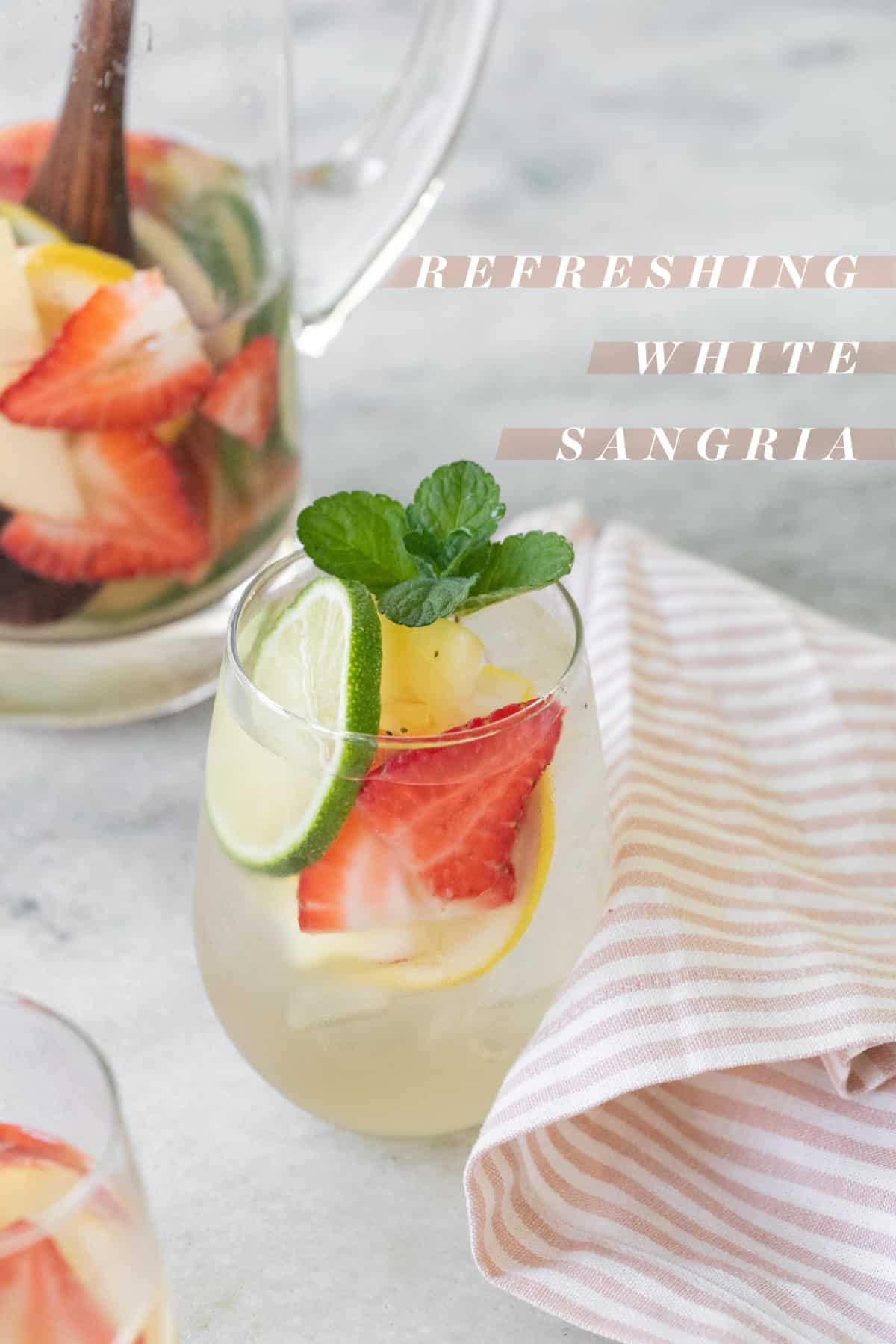 White wine sangria recipe with graphic on the photo.