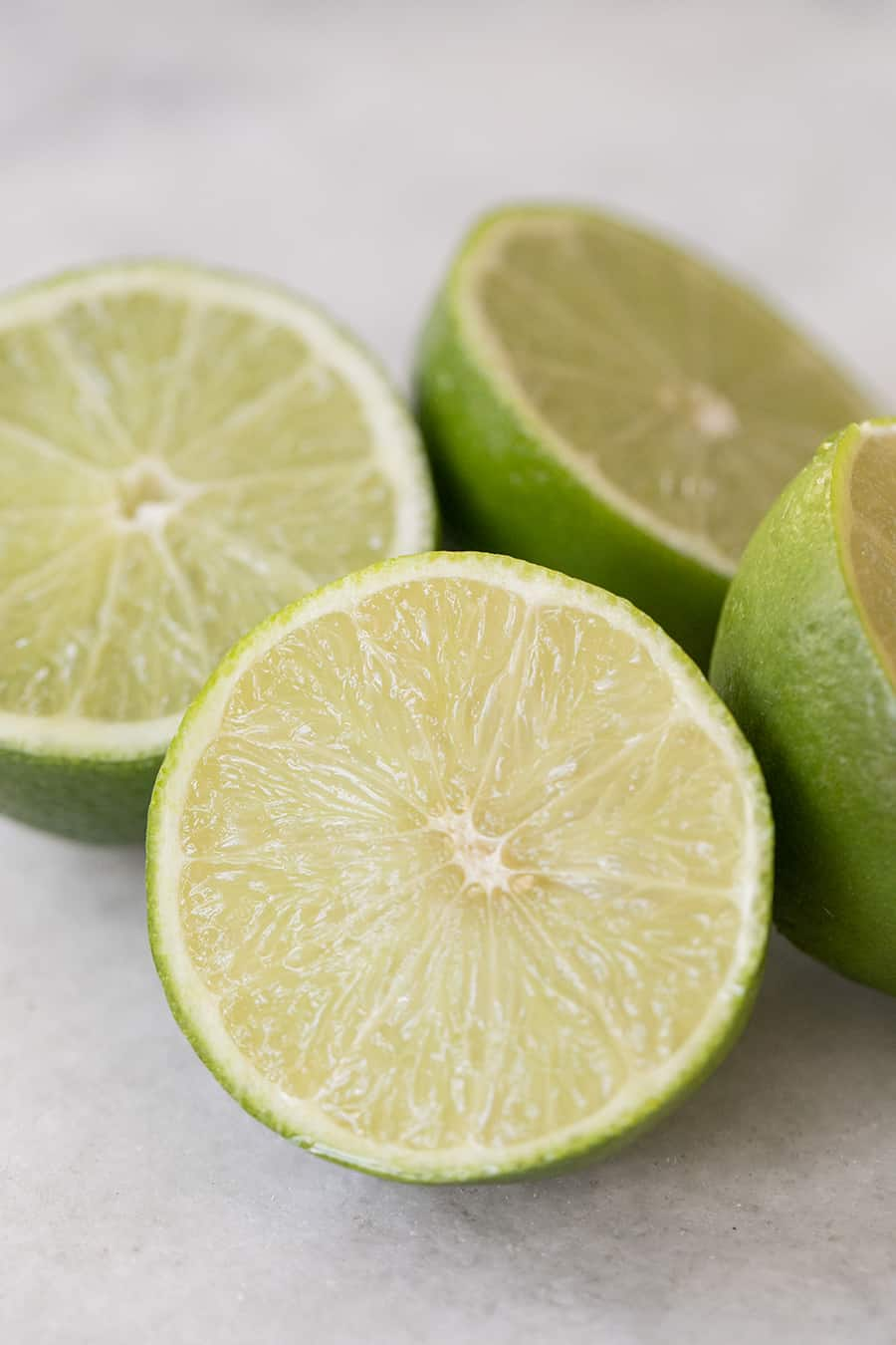 Close-up picture of limes sliced in half.