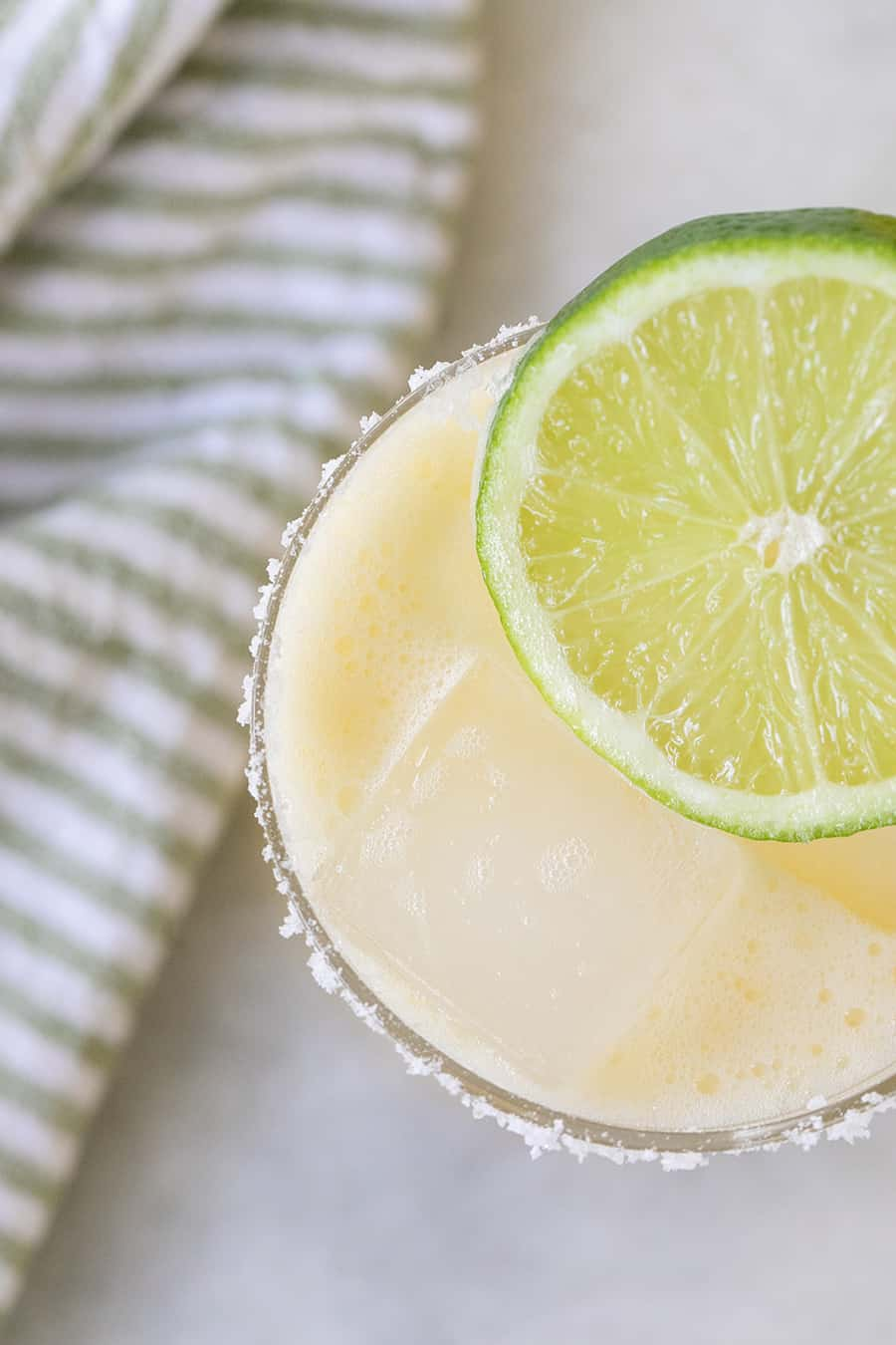 Close up of a margarita with a lime slice.