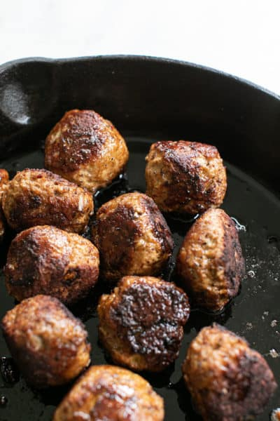 Turkey meatballs cooked in a cast iron skillet