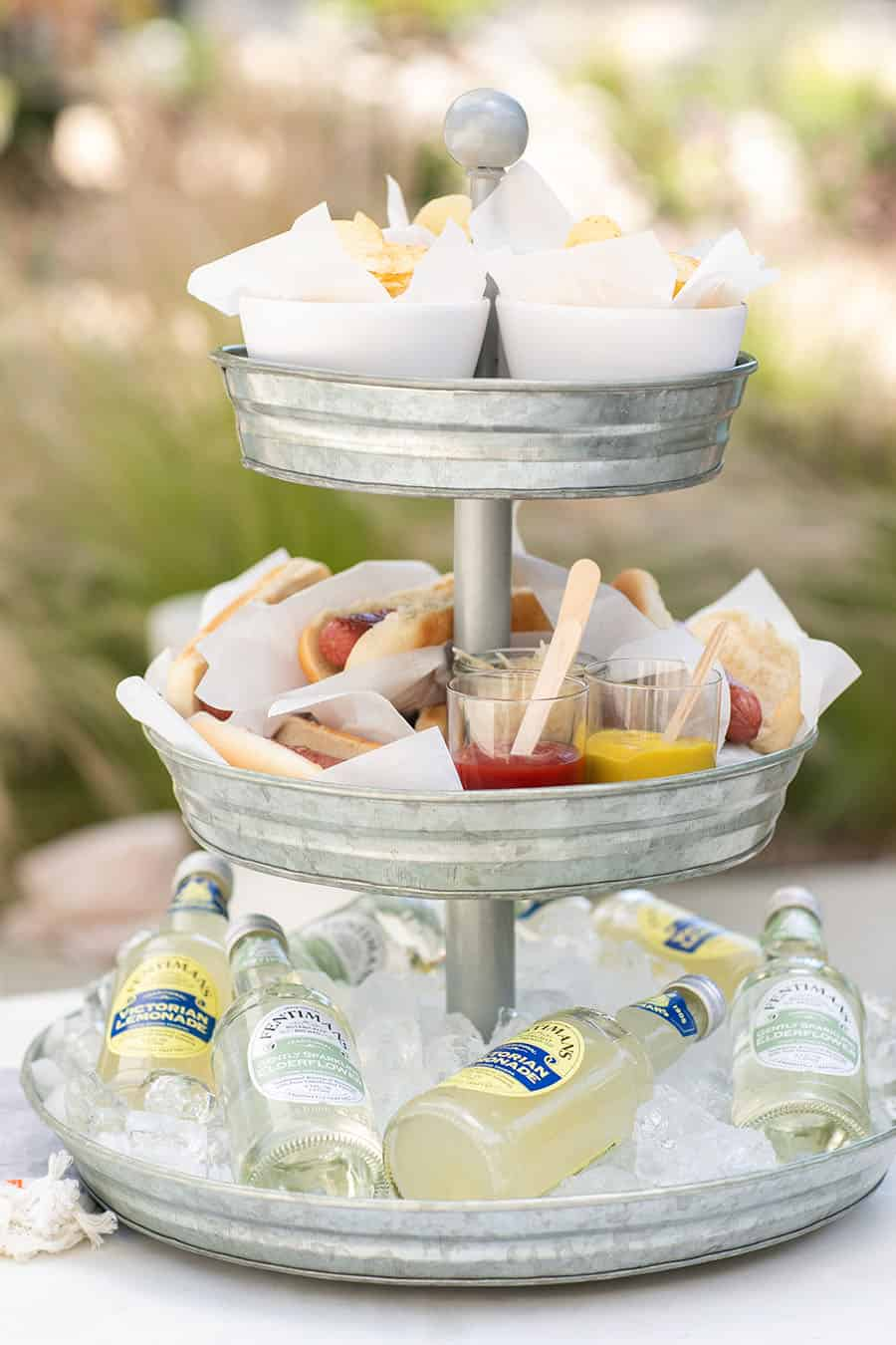 Tiered Galvanized Tray with potato chips, hot dogs and sodas on the bottom