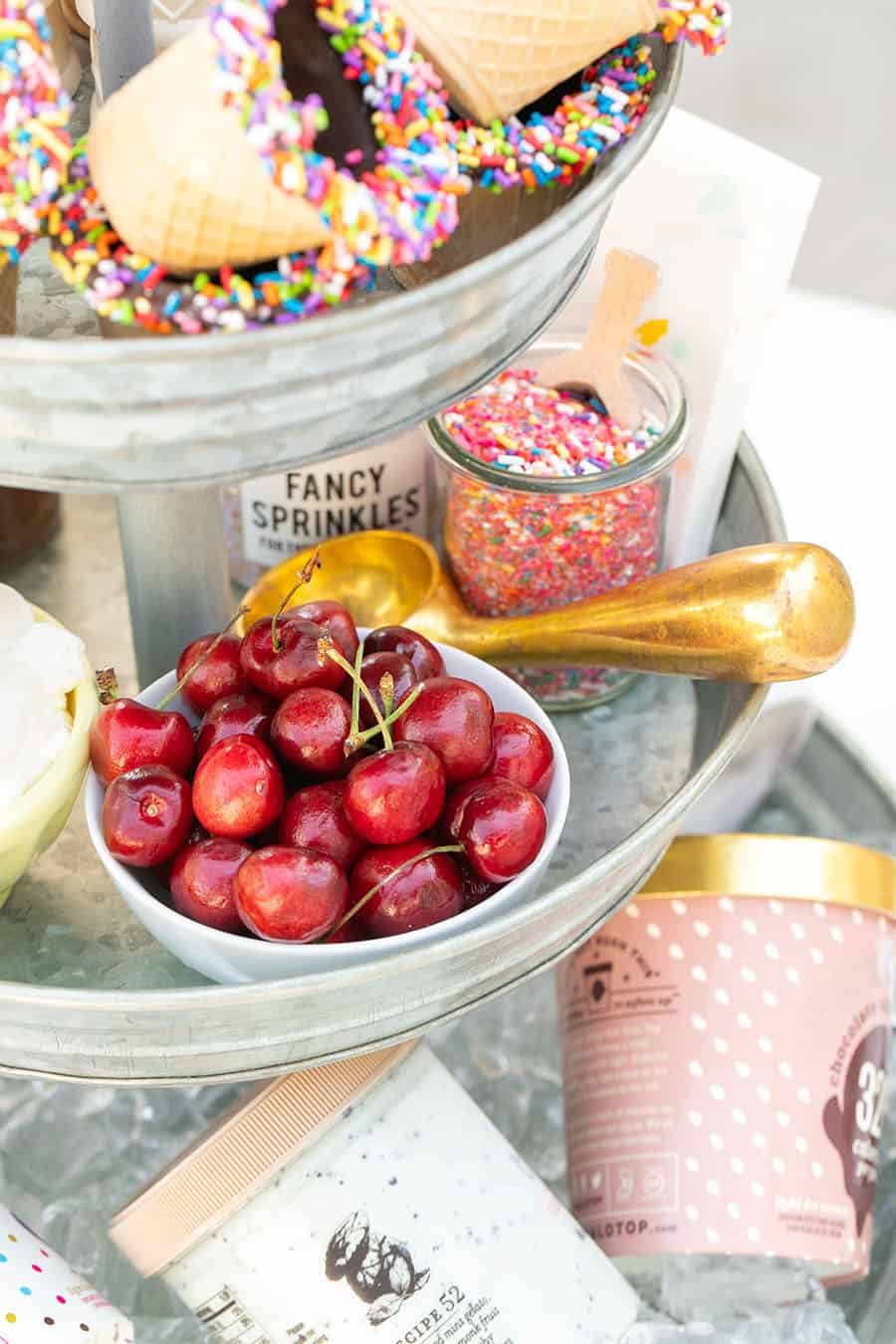 Tiered Galvanized Tray with cherries in white bowl and copper ice cream scooper.
