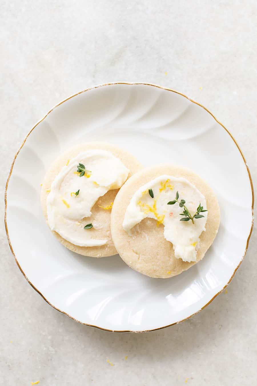 two Lemon & Thyme Shortbread Cookies on a white plate.