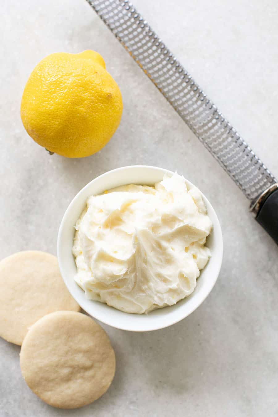 Lemon frosting in a small bowl.