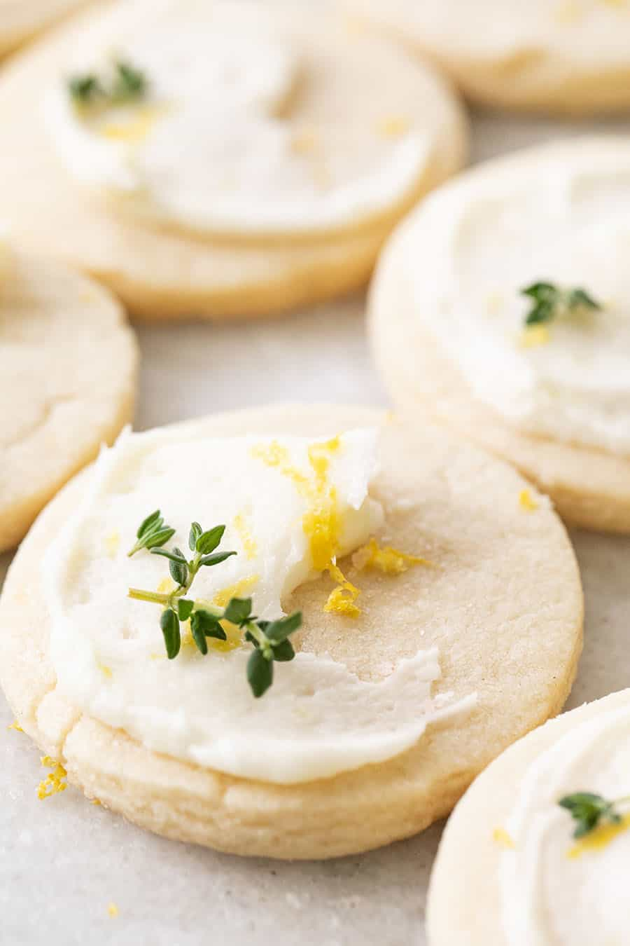 close up of Lemon & Thyme Shortbread Cookies with lemon frosting.