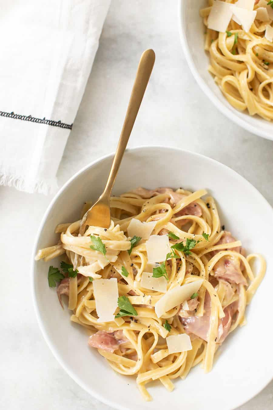 Bowl of One Pan Fettuccine with Prosciutto with gold spoon.