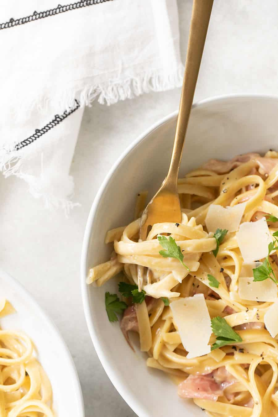 One Pan Fettuccine with Prosciutto with fork and cheese.
