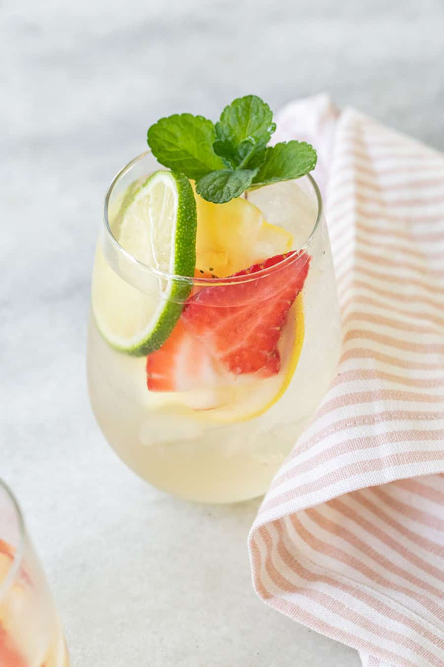 Sangria with lime, strawberry and lemon and a fresh sprig of mint.