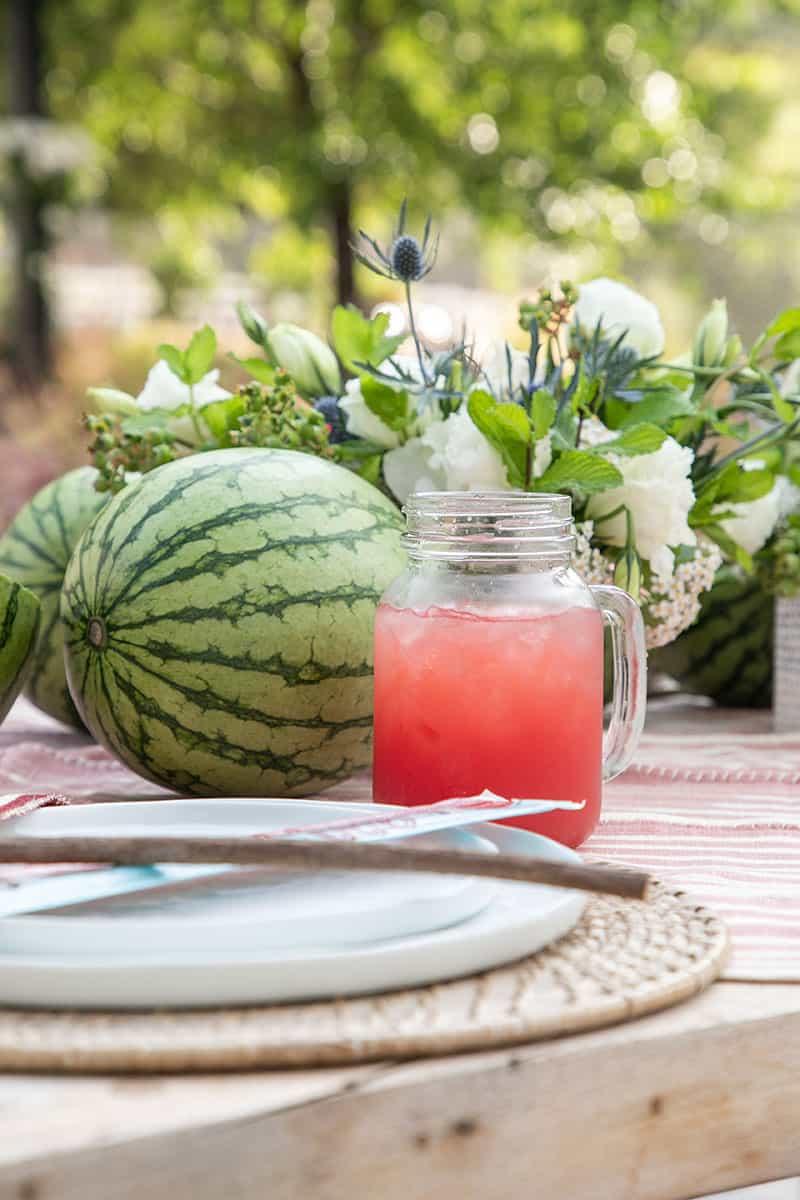 Mason jar mug filled with watermelon juice.