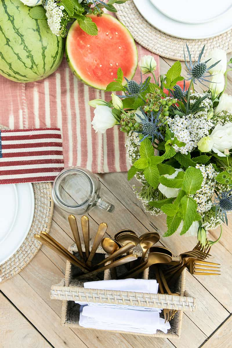 outdoor 4th of july party with flowers, silverware caddy