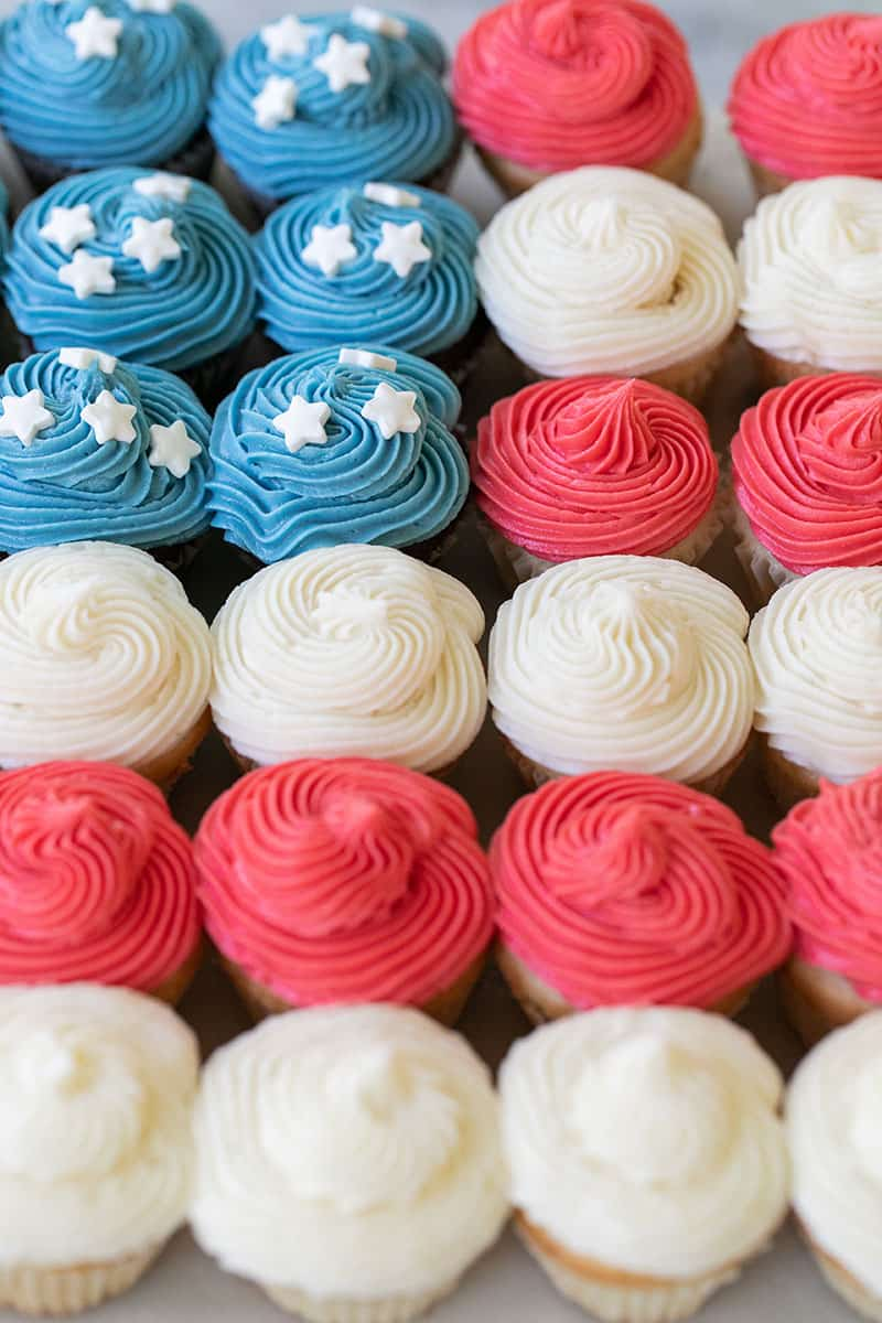 Cupcake cake in the shape of a flag with red, white blue cupcakes.
