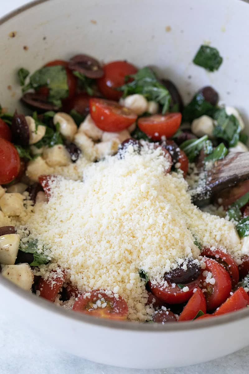 Parmesan cheese in a bowl of summer pasta salad.