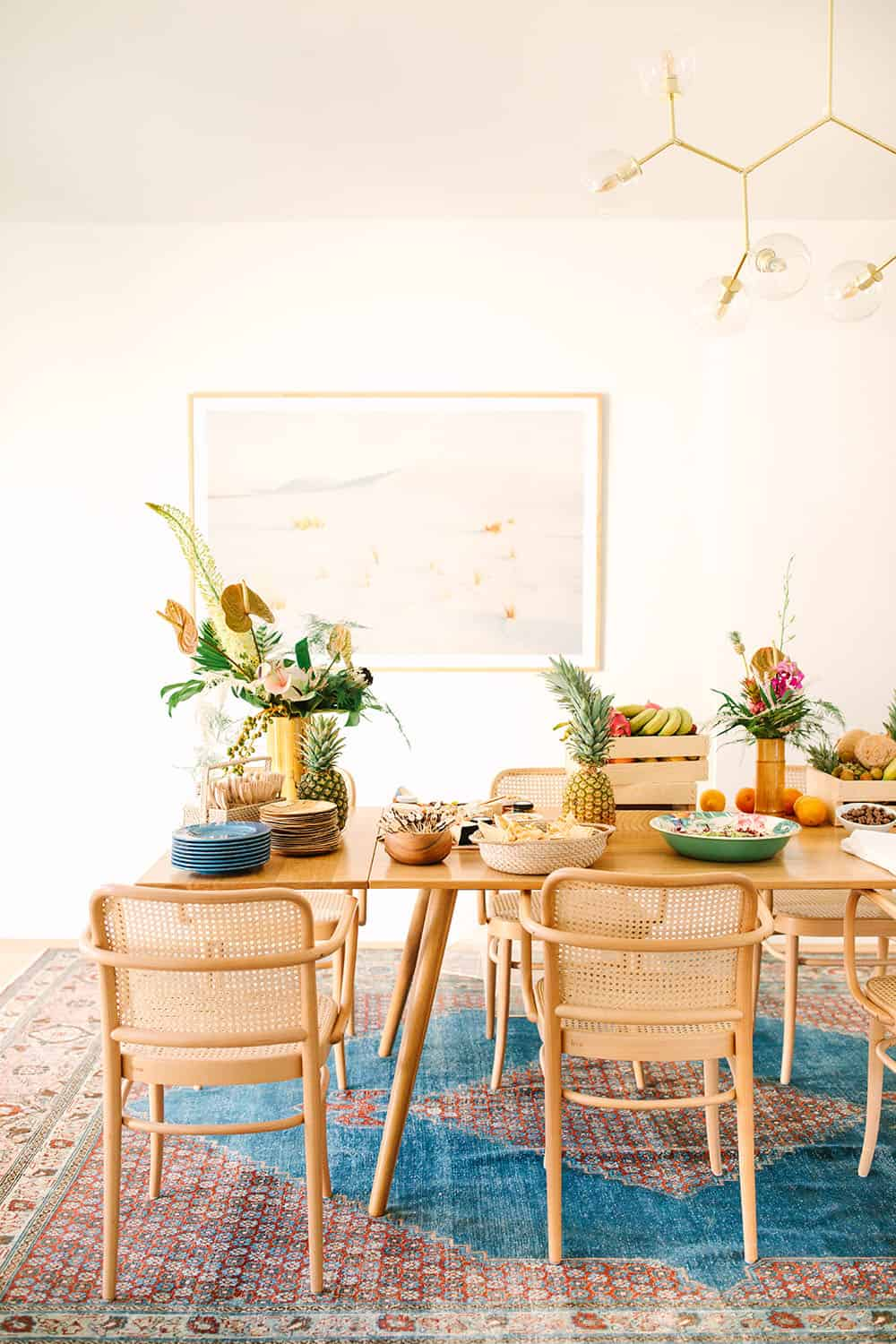 Tropical party and food in dining room.