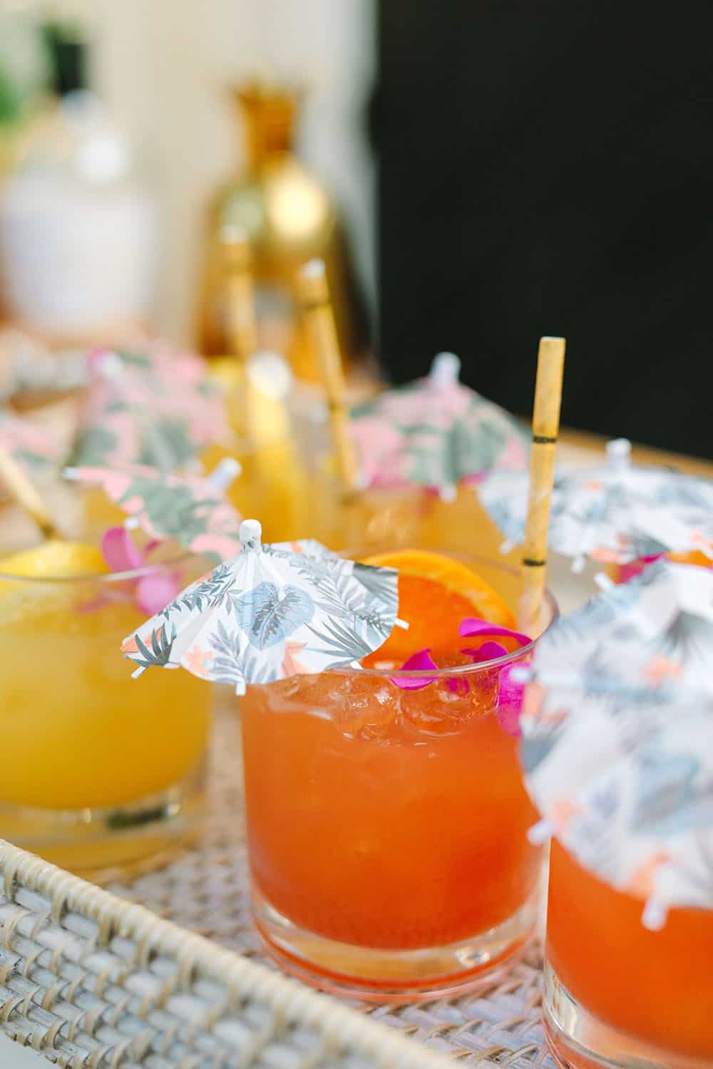 Tropical cocktails with cocktail umbrellas and bamboo straws.