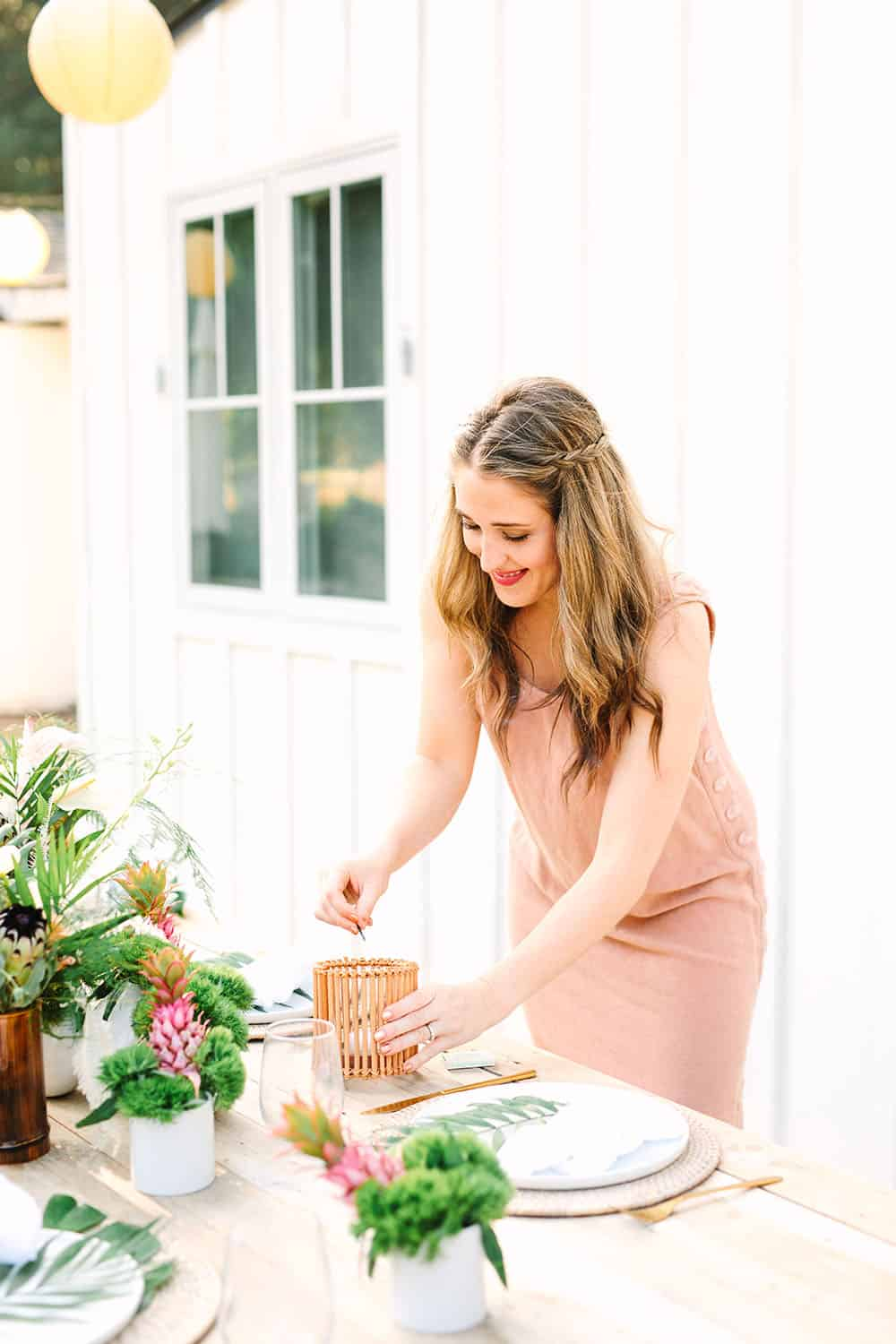 Eden Passante lighting a candle for a tropical party