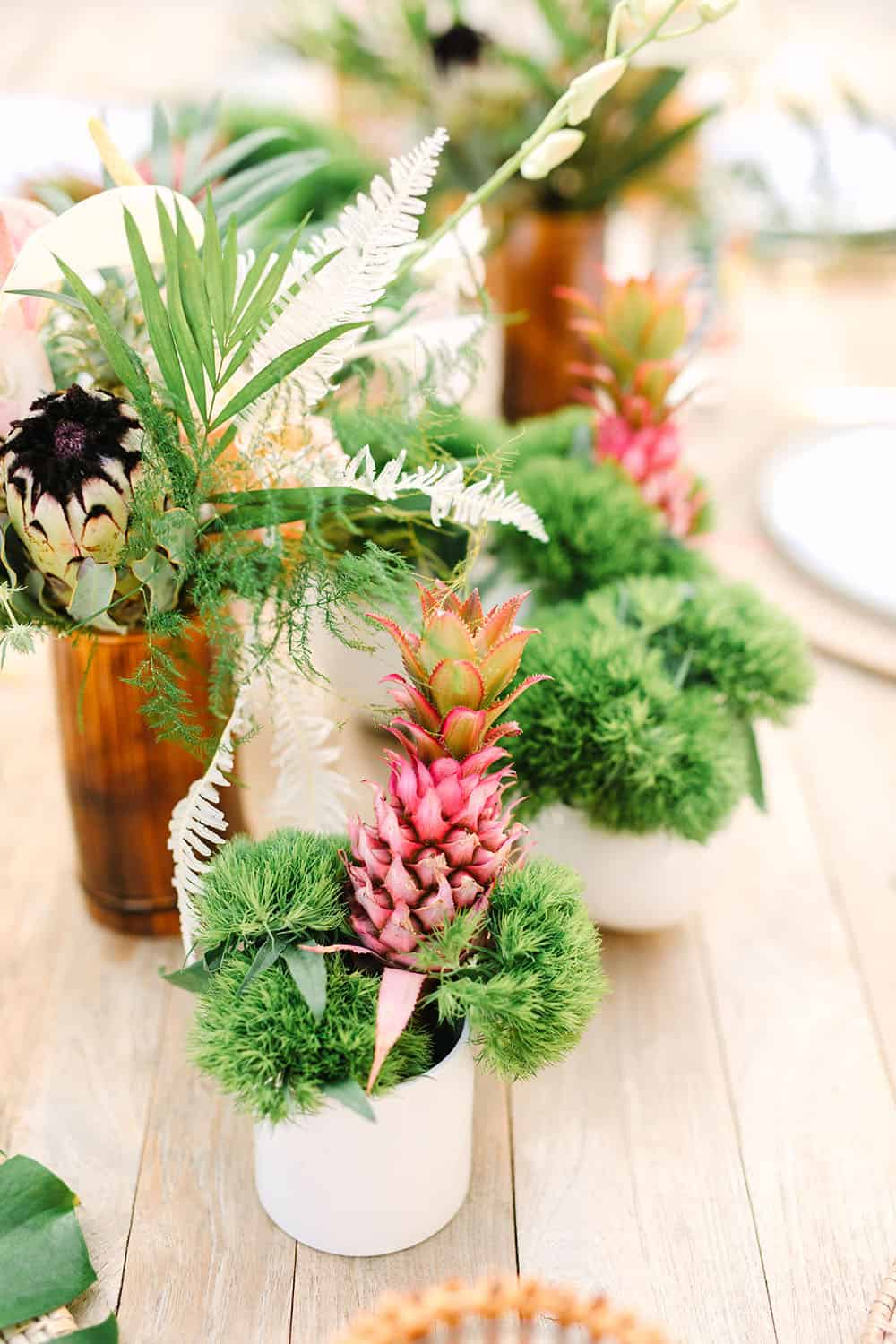 Tropical flowers and a pink pineapple for a backyard party.