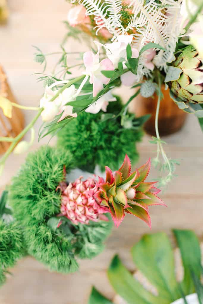 Mini pink pineapple and tropical flowers.