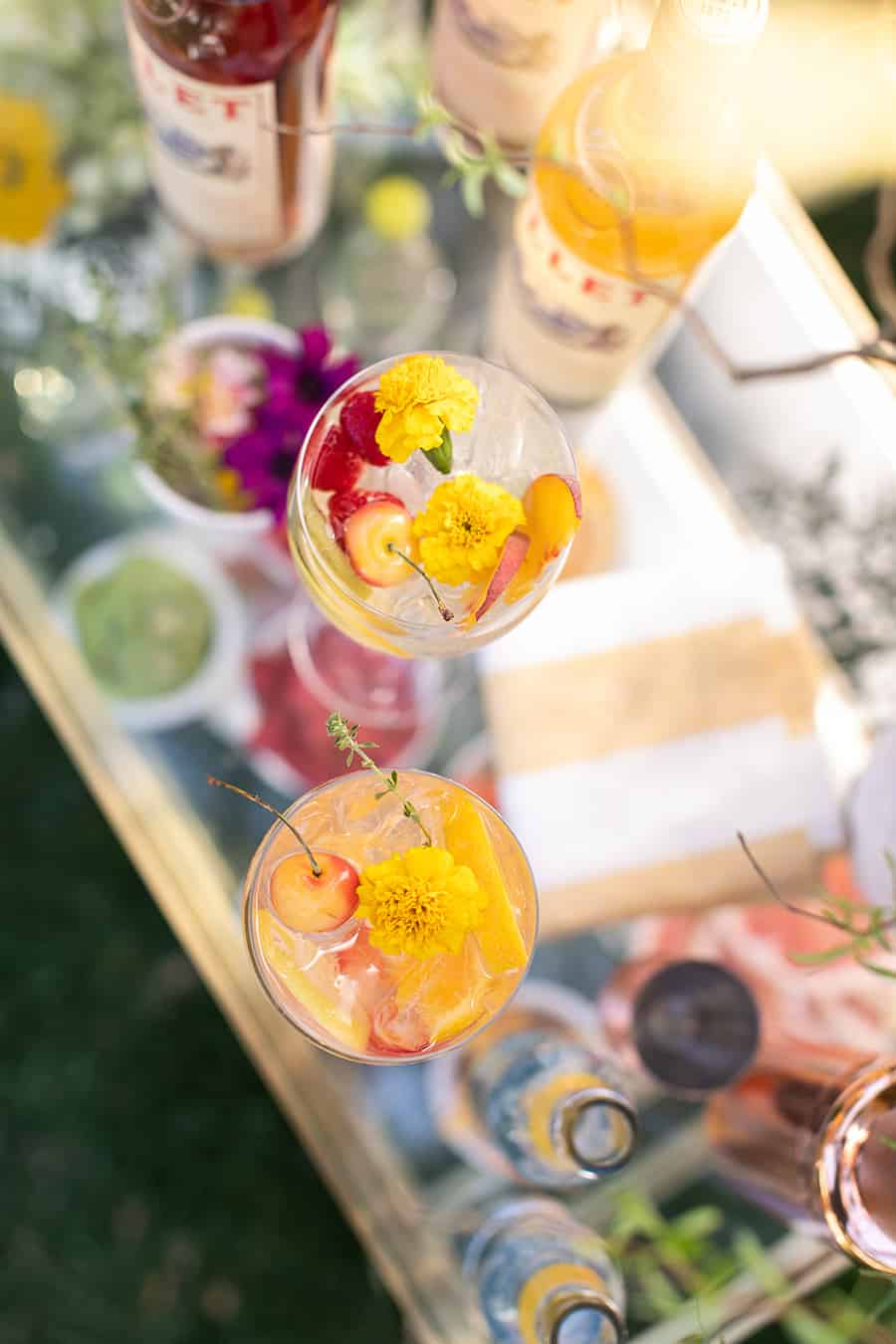 overhead on cocktail with edible flowers