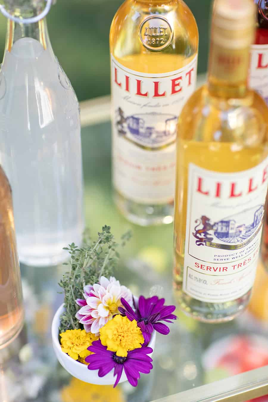 Lillet on bar cart with flowers