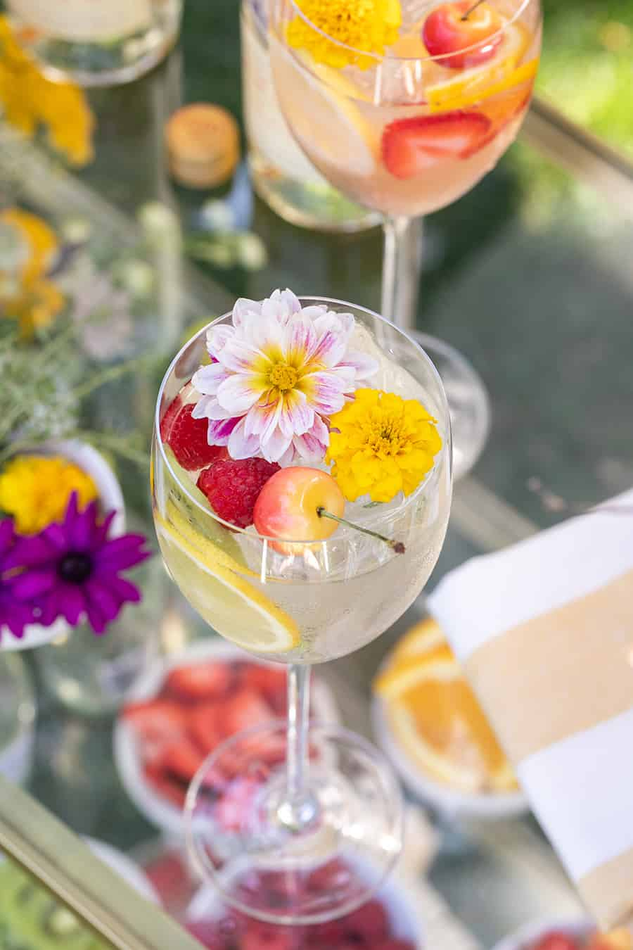 Spritzer with edible flower and cherries