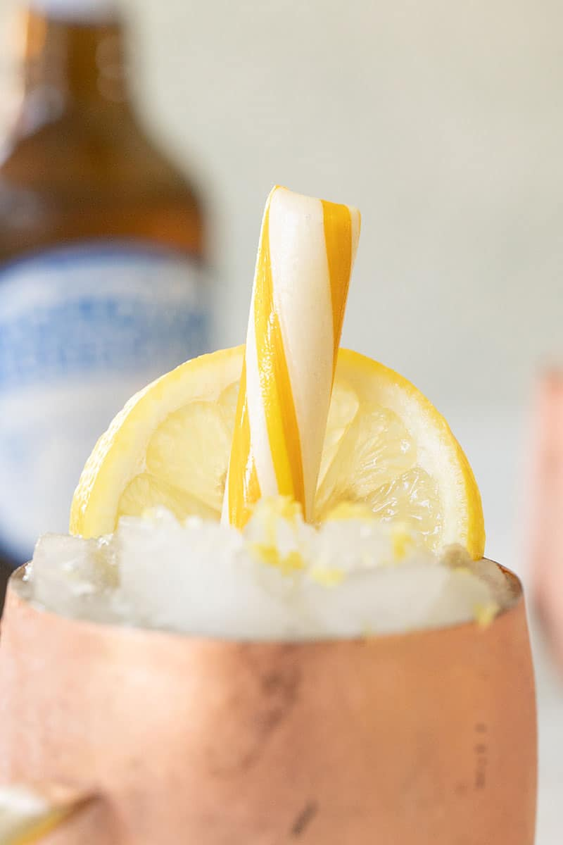Close up photo of a classic lemon stick in a Moscow Mule.