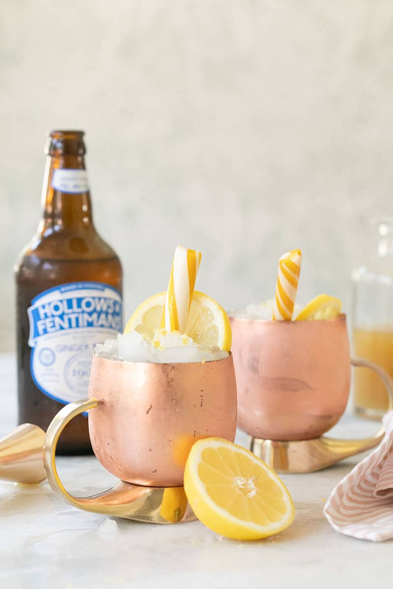 Lemon Mules in a copper mug with a lemon candy and ginger beer.