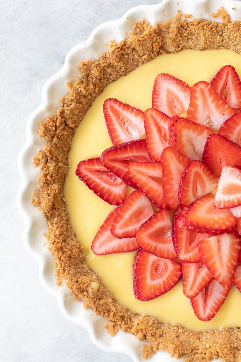 Close up of sliced strawberries on a lemonade pie.