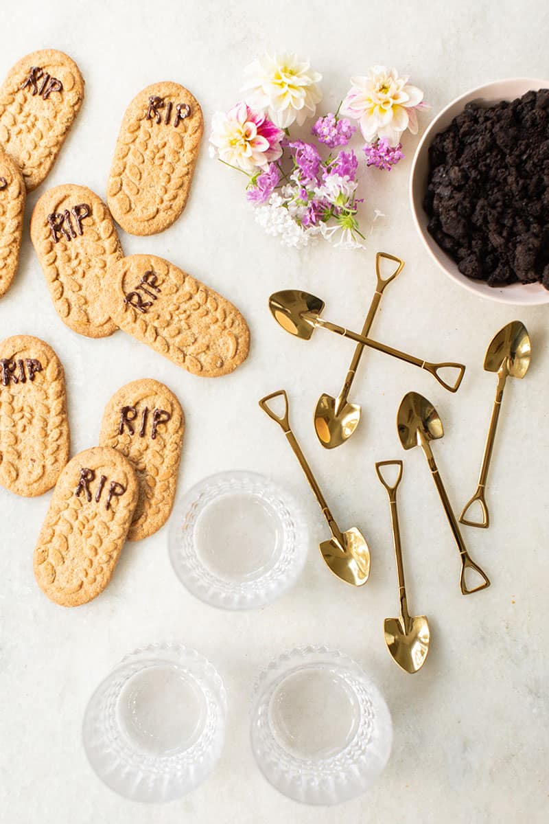 Gold shovels, glasses and cookie tombstones with RIP written in chocolate.