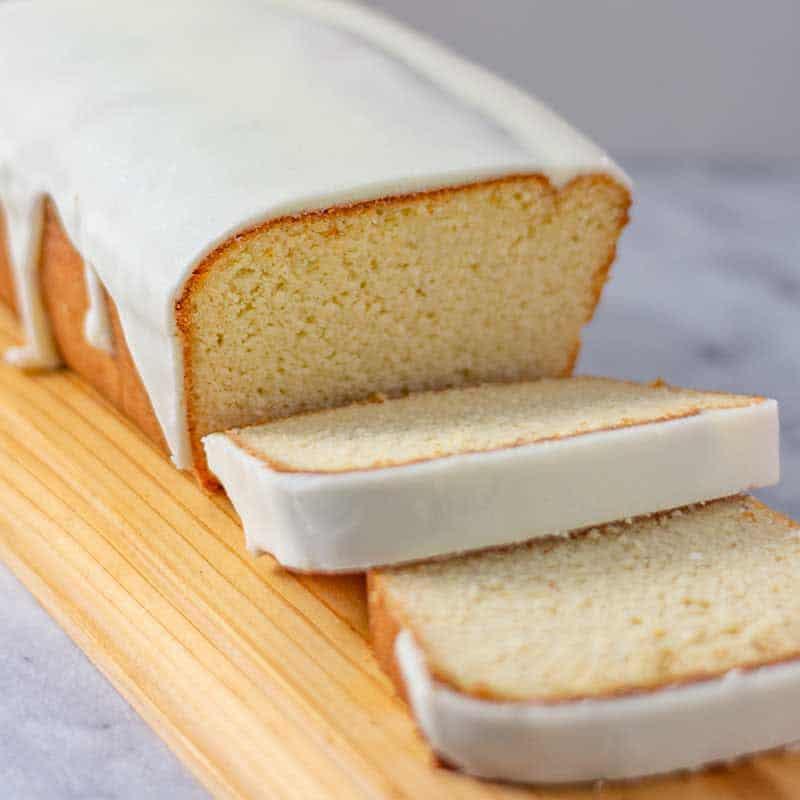 Lemon pound cake sliced with vanilla glaze.