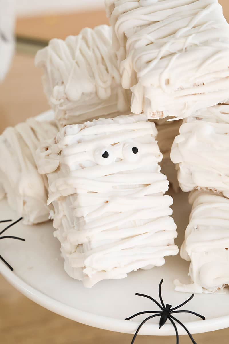 Mummy rice krispies treats on a cake stand.
