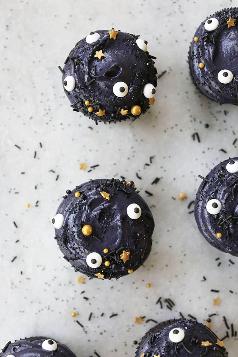 Overhead photo of black velvet cupcakes with sprinkles for Halloween
