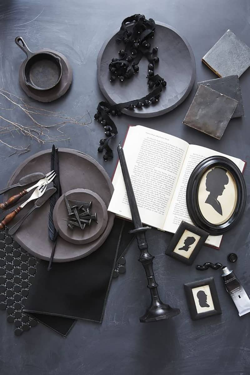 Black plates and a book for a spooky Halloween party ideas