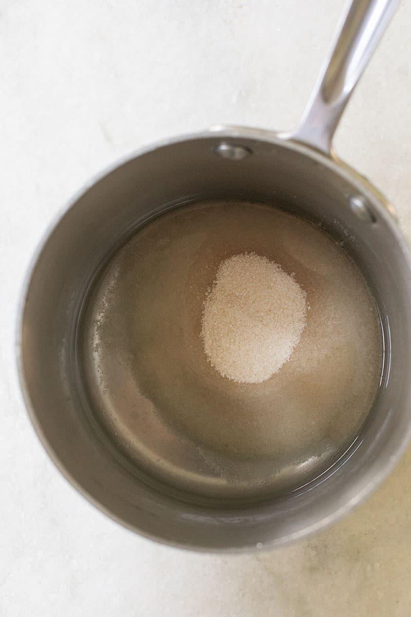 Sugar melting inside of a sauce pan.
